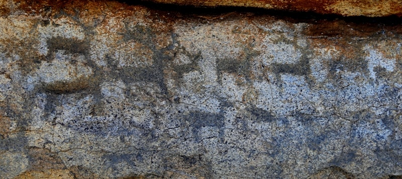 Rock paintings in Akbaur.