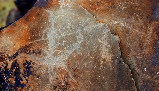 The Person on horse with spear. Petroglyphs the Bayan-Zhurek.