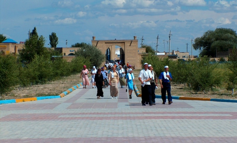 Pilgrims in the neighborhood of the mausoleum Arstan bab.
