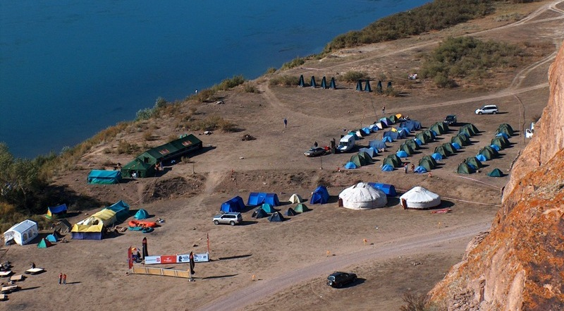 Camp of tourists on coast of the river Ili.