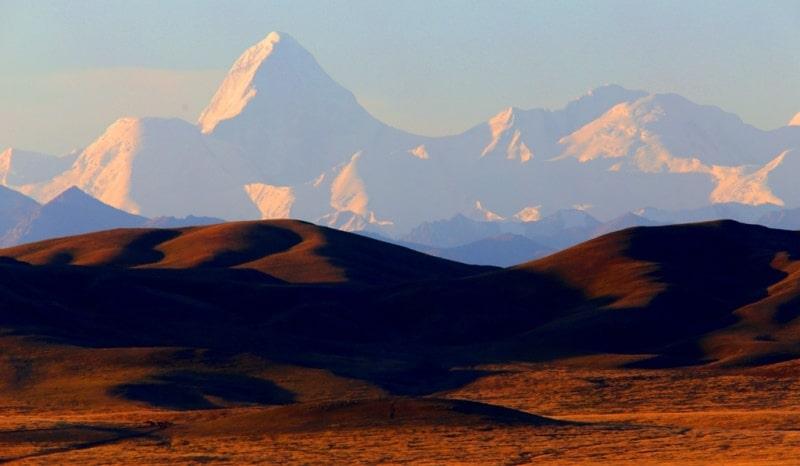 Peak of Khan-Tengri. Sarydzhaz ridge. View from lake Tuzkol.