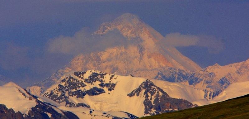 Peak of Khan-Tengri. Sarydzhaz ridge. View of the natural boundary Dzhaman-Echkilitash. Kyrgyzstan.