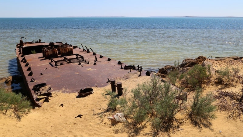 The barge is on Aral Sea and environs in the gulf Butakov.