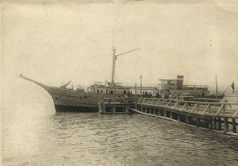 "Postcard of 1930. Unloading of the steamship ""Pioneer"" on the lake Issyk-Kul."