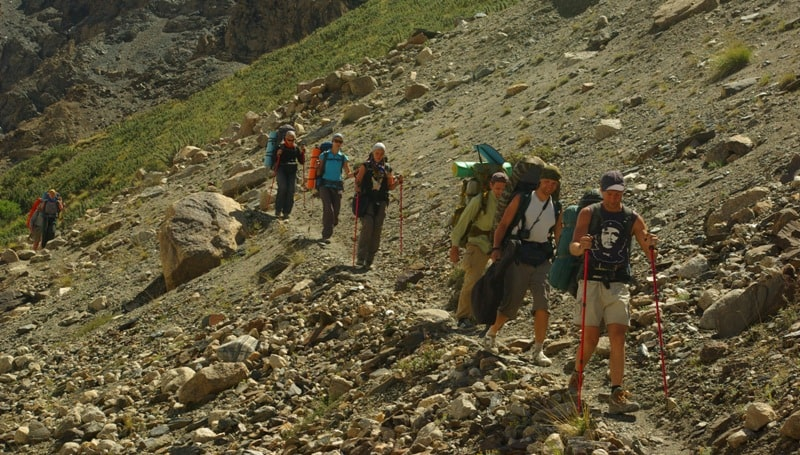 Group of tourists between camps At-Dzhailoo and Peak Nansen.