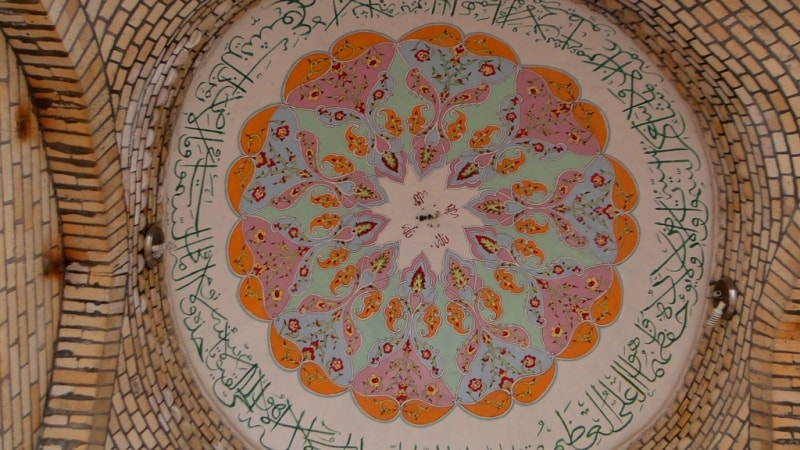 Painted ceiling of a dome in Makhdumi Azam the mausoleum.