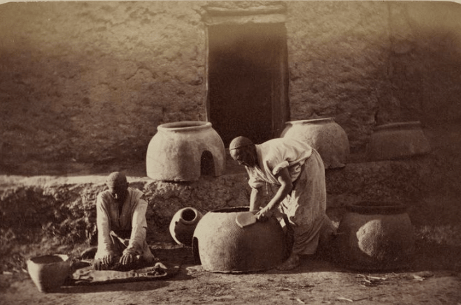 Potter's manufacture. Manufacture of a pottery for a batch of bread. Photos from the Turkestan album. (1871 – 1872).