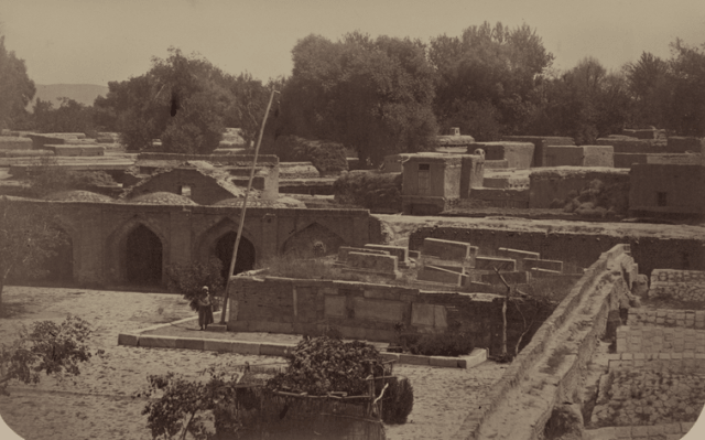 Sheibani-Khan madrasah and the ruins of the Kuskunchi Khan mausoleum. View of the courtyard and the tomb of Sheibani Khan. Photo from Turkestan album.